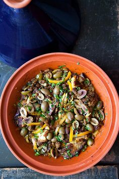 Moroccan Chicken with Lemon and Olives ~ A traditional Moroccan dish of chicken pieces braised with spices, garlic, onion, olives, and preserved lemon. Cooked in a tagine. ~ SimplyRecipes.com