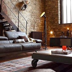 Stylish living room with exposed brick 🙌🏼 Follow @stylishmanmag for daily style inspiration