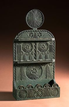 Chip carved spoon rack in green