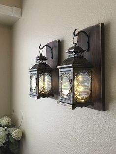 These farmhouse inspired lantern scones are gorgeous! #farmhousedecor #wallsconce #etsy #affiliatelink