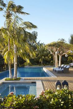 Wicker chairs from Gloster, with cushions in a Champalimaud fabric, offer a cool and soothing spot by the inviting swimming pool. - Veranda.com