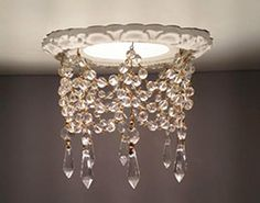 Recessed light trim embellished with clear crystals with silver or gold pins. Available for most sizes of recessed lighting canisters. Check website for finish and crystal options.