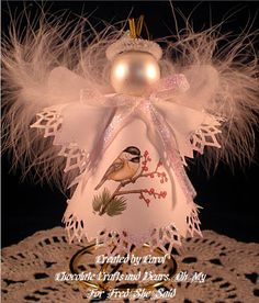 This is a Angel Ornament that I have created from paper. The image you see on this Angel is from the Fred She Said Winter Bird Series Digit...