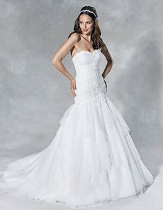 'Marni' - This strapless fit and flare gown is as flattering as it gets. Dreamy tulle wraps around the waist and cascades to the floor in soft layers. The delicate beaded lace applique is the perfect finishing touch. Wedding Dress Shapes, Fit And Flare Wedding Dress, Princess Wedding Dresses, Bridal Gowns, Wedding Gowns, Grace Kelly Wedding, Ball Gown Dresses, Vintage Bridal, Bride