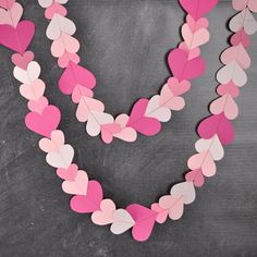 Spread love with this sewn paper heart garland! Click through for 2 FREE printable templates!