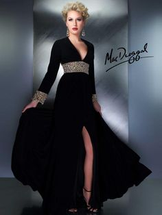 Timeless long sleeve couture gown.  Empire waist and cuffs fully embelissed with jewels.  Open back, high leg slit and plunging neckline give just the right amount of sex appeal.   This is the perfect couture evening gown for that black tie event.