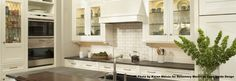 Lighted glass cabinets provide the perfect setting to display favorite collections