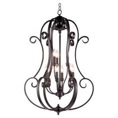 Pairing classic elegance with contemporary appeal, this beautifully crafted luminary brings artful allure to your foyer, dining room, or living room.  Product: ChandelierConstruction Material: Steel and glassColor: Oil rubbed bronzeFeatures:  White frosted glass shadesDecorative scroll iron work Accommodates: (9) Candelabra E12 bulbs - not includedDimensions: 39.25 H x 25.25 Diameter