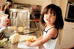 lit girl cooking. aww...cute girl