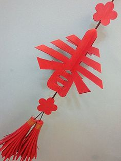 "Craft project with kids: Chinese Paper Cutting pattern - character, ""spring"" for spring festival."