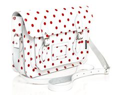 White and red Polka Dot. I'm not sure if I like the purse or just the polka dots.
