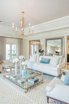 luxury home accents Luxury interior design. South Florida interior designer Alicia Weaver designed a living room in gorgeous neutral shades of white and blue. White couch with blue accent pillow and gold chandelier make this living room space stand out! Coastal Living Rooms, Elegant Living Room, Elegant Home Decor, New Living Room, Formal Living Rooms, Home Interior, Interior Design Living Room, Living Room Designs, Blue And Gold Living Room
