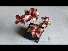 Cómo hacer flores con alambre y esmalte de colores