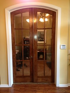 We took an opening and added a beautiful 8-panel, tempered glass, with external molding, arched top solid wood doors. Customer wanted to be able to actually use their office space.