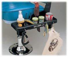 Seat Caddy™ for Boat Seats | Bass Pro Shops.  Something to hold cell phones and jig bodies.  Looks a little small to hold an actual glass.