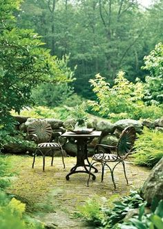A Gardener's Tale SWEET SPOT: Marney repeats the brickwork found in the herb garden in a sweet dining terrace. Chairs found at an by annarose