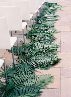 tropical modern wedding ceremony -- leaves framing the aisle