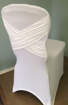 diamond x spandex chair cover in white with a white spandex band
