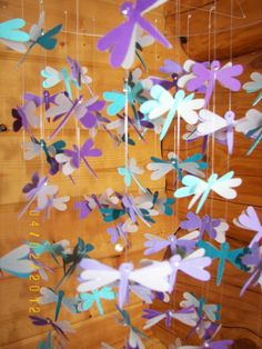 http://www.etsy.com/listing/96764343/teal-and-purple-dragonflies-with-vellum?ref=sr_gallery_29_search_query=paper+hanging+mobile+baby_view_type=gallery_ship_to=ZZ_min=0_max=0_page=7_search_type=handmade