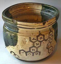 Oribe pottery - late Edo Period C.1860 brazier. Brown feldspar markings along with the trademark Oribe olive green glazes on a white hagi base.