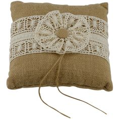 This burlap ring bearer pillow is perfect for a casual or rustic wedding. The top has a lace overlay that lets the natural burlap show through. Tie the rings to the pillow with the attached jute strin