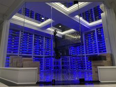 Modern wine room Acrylic wine racks w led lighting throughout, antique mirror coffer ceiling, seamless glass, and ti Just Wine, Wine Cellar Design, Coffer, Wine Collection, Wine Racks, Wine Storage, Cool Paintings, Tile Floor, Modern Design