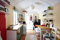Everything in a small space should be able to multitask, including cupboards, sofa beds and dining tables.  This is the vacation home (travel trailer) of Rina & Matthias in Germany. small house, small home, tiny house, tiny home, small spaces, small space living, space-saving, compact, convertible, multipurpose, travel trailer, camper, caravan
