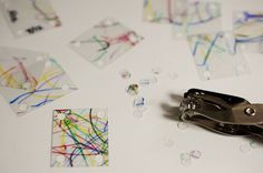 try to make these (recycled) homemade shrinky dink plastic squares for some kind of hanging mobile