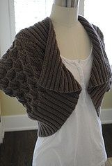 wrap made from a knit rectangle, with pattern.