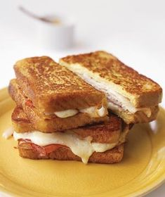 Monte Cristo Sandwich... contains: 3 tablespoons  Dijon mustard; 2  6-count boxes frozen French toast; 1  9-ounce package thinly sliced ham; 1  9-ounce package thinly sliced turkey; 12  slices Swiss cheese; 3  tablespoons mayonnaise (optional); and 6  tablespoons  butter, at room temperature.