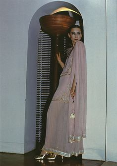 Model Tina Chow in an ensemble by Bill Gibb Photographed by David Bailey for British Vogue, April 1976
