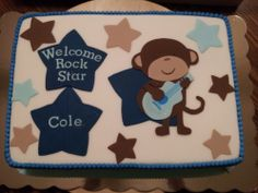 """Monkey Rockstar Baby Shower Cake - Rock Star Baby Shower Cake - strawberry cake with vanilla icing and covered in fondant.  All decorations hand made.  The inspiration for the cake was Carter's """"Monkey Rockstar"""" bedding set chosen by the Mom-to-be."""