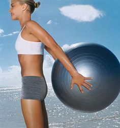 Ball Lift:  Stand with feet hip-width apart, holding a stability ball behind you an inch from butt. Keeping chest up, draw abs in tight, squeeze shoulder blades together and raise ball behind you (as shown); lower to start. Do 20 lifts.