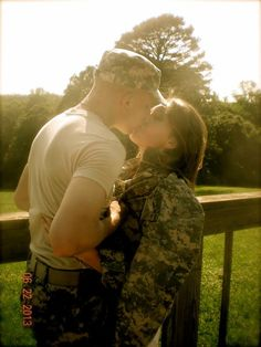 Love passionatley :) Country first Army engagment bride wedding kiss flag stars and stripes  partiotic  deployment love military acu fist 13fox soldier homecoming stealing his last name lee heart eyes hold each other