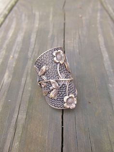 Knuckle Ring Antique Brass Flower Ring Hardware Jewelry Large Cocktail Ring Finger Armor A Game of Thrones Big Ring. $38.00, via Etsy.