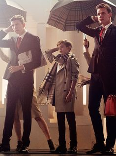 Romeo Beckham in step with the city gents hailing taxis