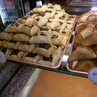 Wonderful! I could eat a dozen. - Meat and Spinach Pies - Shatila Bakery's photo