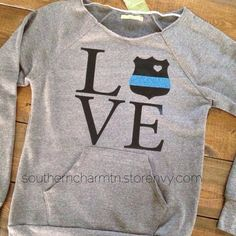 A raw-edge, off-the-shoulder neckline and kangaroo front pocket give this cozy sweatshirt its vintage-inspired appeal. Made with natural fleece alternative, it's the perfect way to stay warm in style. Police Girlfriend, Cop Wife, Police Officer Wife, Police Wife Life, Police Family, Police Love, Support Police, Leo Love, Slouchy Sweater