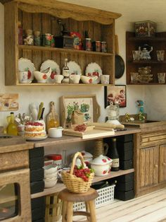 Beautiful miniature kitchen. I like the idea of using the top of a china cabinet instead of cupboards on the wall. Much prettier.