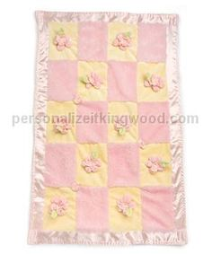 """Daisy Stroller Blanket. Soon to be the favorite blanket, it's the perfect size to drape over baby in stroller or car seat. Beautiful soft daisies and busy bugs cover the front of this pink fur and yellow velour blanket with matching yellow velour back. Machine wash & dry no heat. Size: 21"""" x 33"""""""