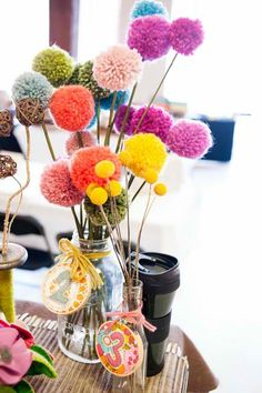 Love the Pom Pom center pieces in glass jars of varied sizes!  Easy and cute!