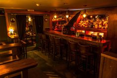 The Dark Horse features flourishes of architectural salvage, such as the bird of prey at the bar