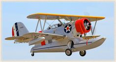 """Several types of amphibious aircraft produced by Grumman from 1933-1945.Most prominent were JF & J2F series,based on Grumman G-15 design,both carrying the name """"Duck."""" 2-seat general-purpose scout & observation aircraft.Landing gear retracted into side of main pontoon,integral with fuselage.Grumman used same type of gear on many 1930s-era fighters,up to the F4F Wildcat."""