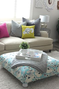 DIY ottoman made from an as-is IKEA ottoman by Petite Party Studio, perfect for our loft