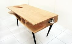 It's the CATable designed by Ruan Hao from the Hong Kong-based architecture firm LYCS. This elegant modern table is filled with passageways and hideouts for cats to explore and hangout in.