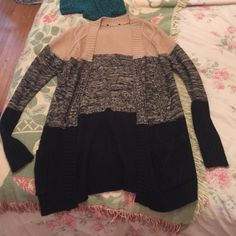 Forever 21 sweater Tan and black forever 21 cardigan. Never worn, I cut out the tag cause it itched my back Forever 21 Sweaters Cardigans