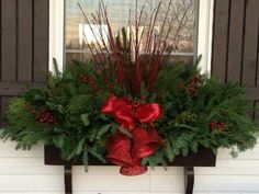 Window Box with red picks and coordinating red bow.Traditional Window Box with red picks and coordinating red bow. Christmas Window Boxes, Winter Window Boxes, Christmas Urns, Outdoor Christmas Decorations, Christmas Holidays, Christmas Wreaths, Box Decorations, Outdoor Christmas Planters, Winter Decorations