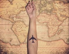 A map of the world with a tattoo of an airplane.  #map #worldmap #globe #world #travel #wanderlust #fly #airplane #plane #vintage #photography