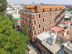 "Completed in 2017 in Ciudad de México, Mexico. Images by Diana Arnau. EMILIANO ZAPATA is a six floor Housing Project with 25 units located in Eje 7 ""A"" Sur General Emiliano Zapata, on a central neighborhood of Mexico. Brick Architecture, Urban Architecture, Sustainable Architecture, Amazing Architecture, Tropical House Design, Tropical Houses, Brick Building, Building Design, Patio Central"