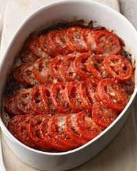 This is so perfect for ripe tomato season. Also looks hearty and perfect for a chilly fall meal! - Tomato Gratin from foodandwine.com.